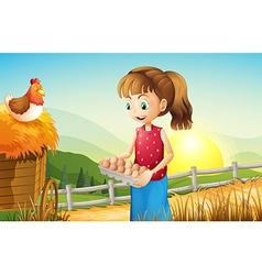 A young girl holding an egg tray vector