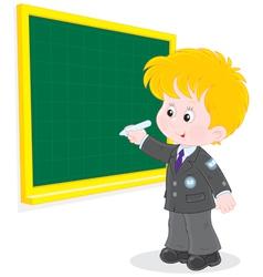 Schoolboy writes on blackboard vector