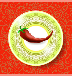 Hot red pepper on ornamental tablecloth vector