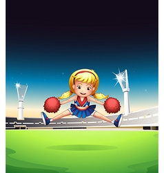 A little cheerleader in the field vector image vector image