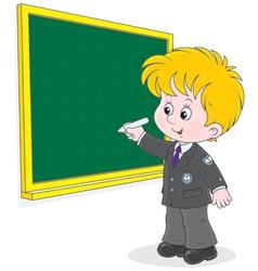 Schoolboy writes on the blackboard vector