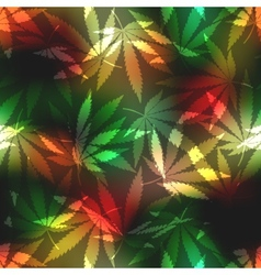 Cannabis leafs on blur rastafarian background vector