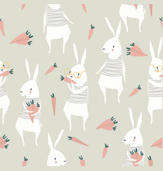 seamless pattern with cute rabbits and carrots vector image