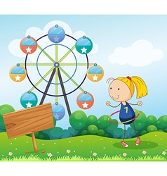 A girl playing with the hula hoop near the empty vector image