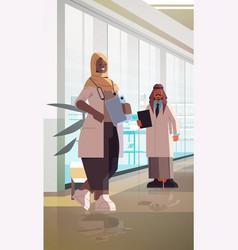 Arabic doctors couple in uniform standing together vector