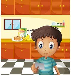 A boy reading a recipe vector image vector image