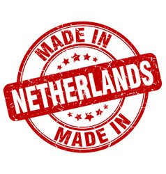 Made in netherlands red grunge round stamp vector