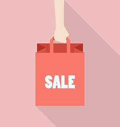 Hand hold shopping bag in flat style vector image