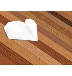 Origami heart on wooden background EPS8 vector image