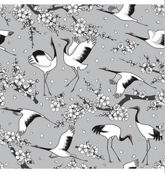japanese cranes and blossoms seamless pattern vector image