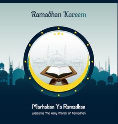 Marhaban ya ramadhan with mosque and quran vector