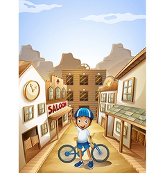 A boy and his bike near the saloon bar vector