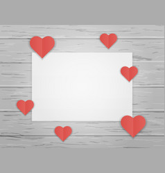 Red origami paper hearts on wood board background vector