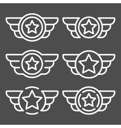 Set of the white emblems with wings vector