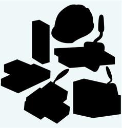 Trowel hard hat and bricks vector image
