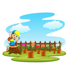 Kid playing in the garden vector