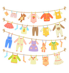 baby clothes hanging on rope isolated vector image