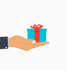 gift box with ribbon in hand vector image