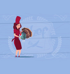 Female chef cook holding turkey cartoon chief in vector