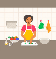 black woman cuts vegetables for salad in kitchen vector image