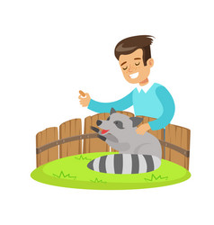 Smiling little boy petting and feeding a raccoon vector