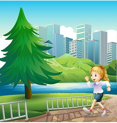 A girl running at the riverbank with a tall pine vector image vector image
