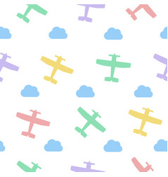 colored airplanes and clouds seamless vector image