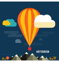 Hot air balloon flying over the mountain vector image