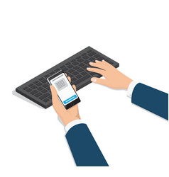 Man typing on computer with phone in hand vector