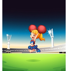 A cute cheerleader performing at the field vector image