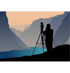 photographer shooting at sunset vector image