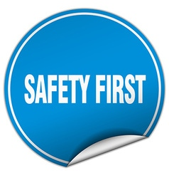 Safety first round blue sticker isolated on white vector