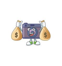 Cute image retro camera cartoon holding money bags vector