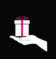 gift box in hand on black vector image