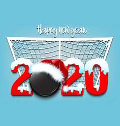 Snowy new year numbers 2020 and hockey puck vector