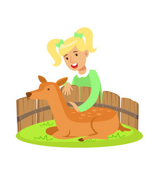 cute little girl petting lying deer in a mini zoo vector image