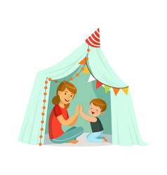 mum and her son playing in a tepee tent kid vector image