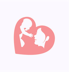 Mother raising a baby in heart shaped silhouette vector