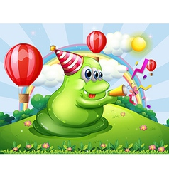 A giant monster at the hilltop with a party hat vector image