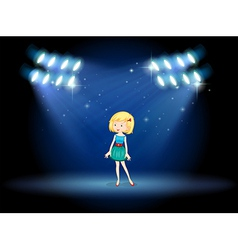 A young actress at the center of the stage vector image