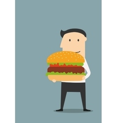 Businessman carrying a big hamburger vector image