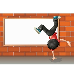 A boy breakdancing in front of the empty board vector