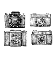 Set of ink hand drawn vintage cameras sketches vector image