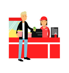 young man buying popcorn in cinema theatre vector image