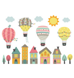 Hot air balloons fly over colorful houses vector