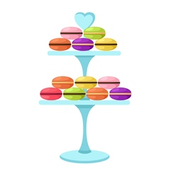 Macarons in a glass cake stand vector