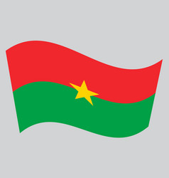 flag of burkina faso waving on gray background vector image vector image