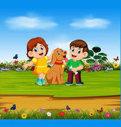 boy and the girl are holding their dog vector image
