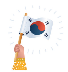 human hands hold south korea flag vector image