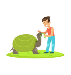 happy little girl feeding with grass a huge turtle vector image vector image